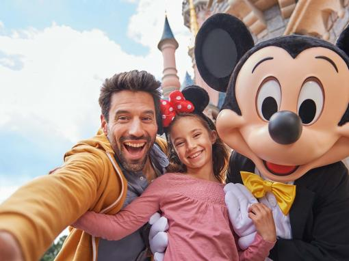 Family with Mickey in front of Sleeping Beauty Castle at Disneyland Paris