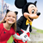 Mickey Mouse and girl smiling